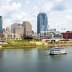 Photo of Cincinnati Ohio skyline  with a riverboat and downtown city office buildings including Great American Ballpark, Great American Insurance Group Tower, Omnicare building, US Bank building, and Scripps Center building. Photo was taken in July 2012.