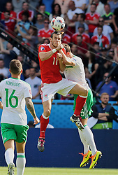 PARIS, FRANCE - Saturday, June 25, 2016: Wales' Gareth Bale in action against Northern Ireland during the Round of 16 UEFA Euro 2016 Championship match at the Parc des Princes. (Pic by David Rawcliffe/Propaganda)