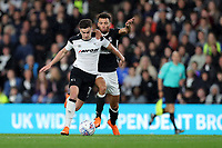 DERBY, ENGLAND - MAY 11: - DCFC vs Fulham. Tom Lawrence, tries to go on a run but is pulled back