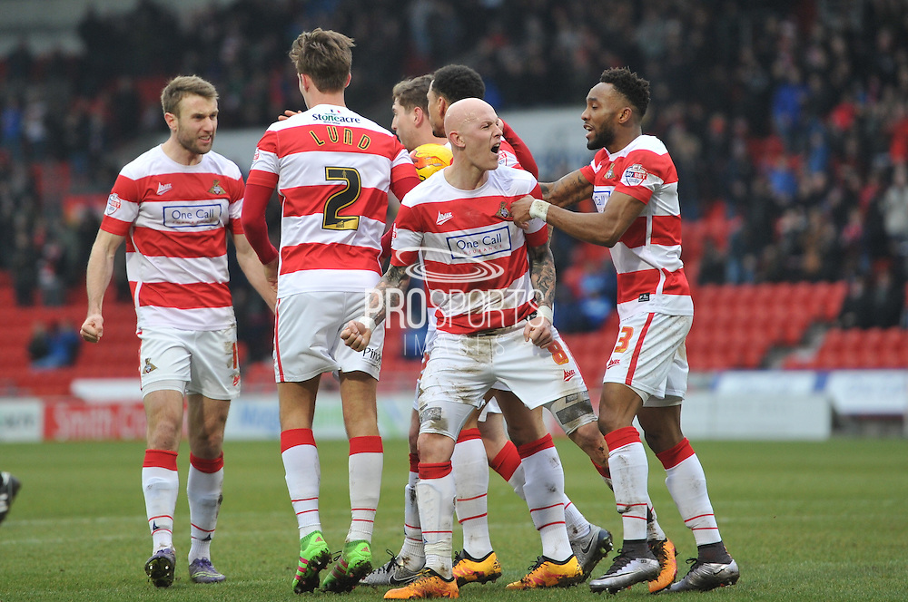Doncaster Rovers celebrate Richard Chaplow of Doncaster Rovers(8) scoring to go level at 1-1 during the Sky Bet League 1 match between Doncaster Rovers and Millwall at the Keepmoat Stadium, Doncaster, England on 27 February 2016. Photo by Ian Lyall.
