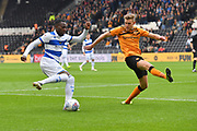 Queens Park Rangers player Bright Osayi-Samuel (20) and Hull City player Callum Elder (26) during the EFL Sky Bet Championship match between Hull City and Queens Park Rangers at the KCOM Stadium, Kingston upon Hull, England on 19 October 2019.