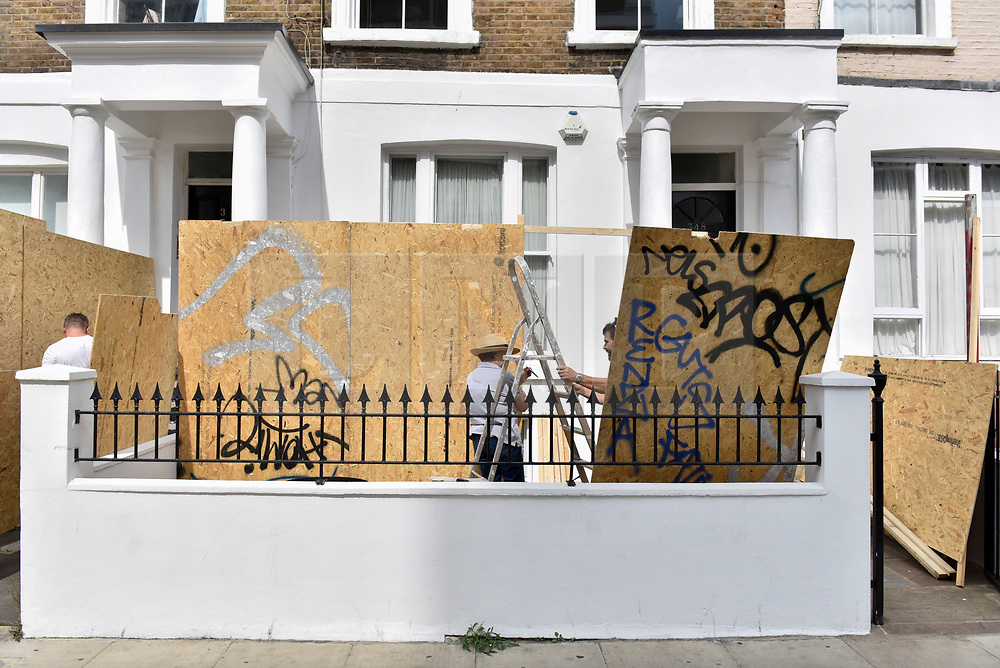 © Licensed to London News Pictures. 24/08/2017. London, UK. Owners begin to board up the front of their properties ahead of the Notting Hill Carnival, the second largest carnival in the world, where a million revellers are expected over the bank holiday weekend. Photo credit : Stephen Chung/LNP