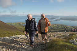 Archbishop of Tuam Dr Michael Neary making his way up Croagh Patrick on Reek Sunday.<br />