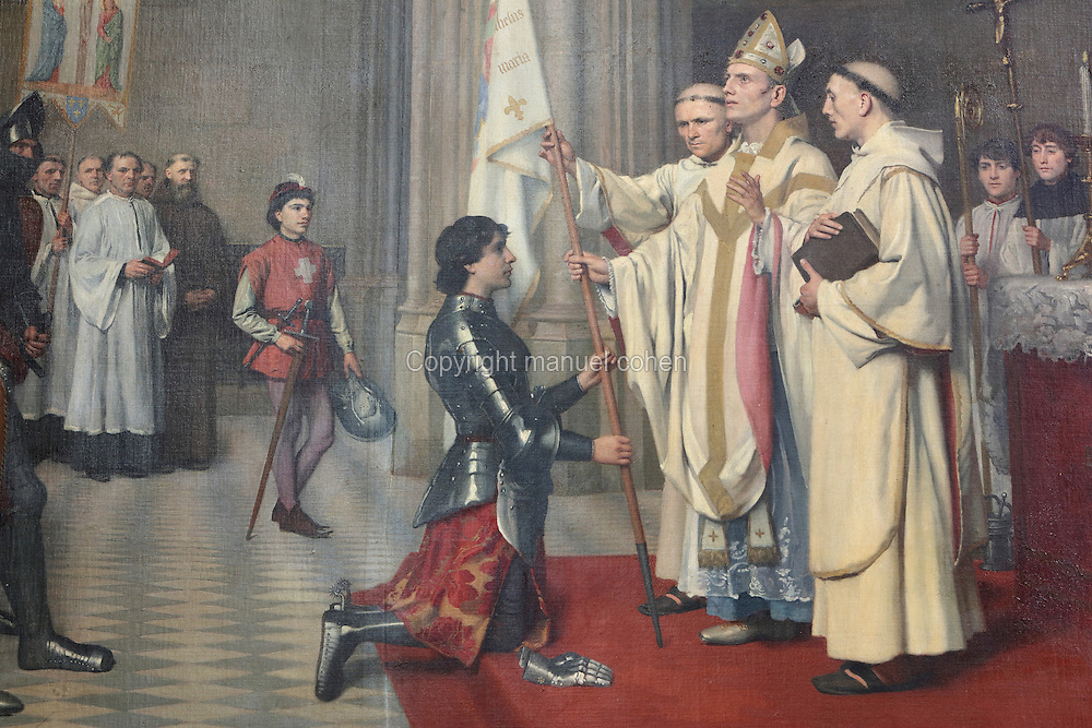 St Joan of Arc has her standard blessed in the Church of Saint-Sauveur in Blois, oil painting, 1901, by Henri Michel, 1817-1905, in the Chapelle Saint-Calais, in the Chateau Royal de Blois, built 13th - 17th century in Blois in the Loire Valley, Loir-et-Cher, Centre, France. This painting marks the saint's time in Blois, 25th-26th April 1429, before the siege of Orleans. The chateau has 564 rooms and 75 staircases and is listed as a historic monument and UNESCO World Heritage Site. Picture by Manuel Cohen