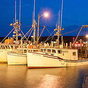 A warm and clear evening in the North Head Marina on Grand Manan, Canada. Boats stay in the marina more and more often, as officials repeatedly drop fishing quotas in the fishery. Photo by William Drumm.