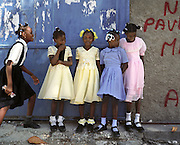 Fillettes endimanche?es a? la sortie de l'e?glise du village de Ti-Mouillage pre?s de Jacmel..Young girls with nice dresses at the exit of the church of the village of Ti-Mouillage near Jacmel.