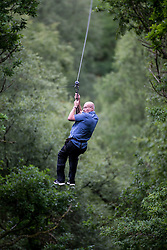 Martin Milner and Colette Gregory tying the knot in the trees at Go Ape Aberfoyle. Father of the bride Simon Gregory arriving of the first zip wire.