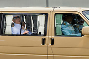 05 MAY 2010 - BANGKOK, THAILAND: Thai King BHUMIPOL ADULYADE (in back seat) is driven into the Grand Palace in Bangkok, Wednesday, May 5. Wednesday was Coronation Day in Thailand, marking the 60th anniversary of the coronation of Thai King Bhumibol Adulyade, also known as Rama IX. He is the world's longest serving current head of state and the longest reigning monarch in Thai history. He has reigned since June 9, 1946 and his coronation was on May 5, 1950, after he finished his studies. The King is revered by the Thai people. Thousands lined the streets around the Grand Palace hoping to catch a glimpse of the King as his motorcade pulled into the palace. The King has been hospitalized since September 2009, making only infrequent trips out of the hospital for official functions, like today's ceremonies.   PHOTO BY JACK KURTZ