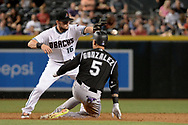 Apr 28, 2017; Phoenix, AZ, USA; Colorado Rockies outfielder Carlos Gonzalez (5) slides into second base in front of Arizona Diamondbacks infielder Chris Owings (16) for a double during the sixth inning at Chase Field. Mandatory Credit: Jennifer Stewart-USA TODAY Sports