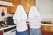 "EXCLUSIVE<br /> A DAY IN THE LIFE OF TWO FEMINIST, CANNABIS-GROWING NUNS<br /> <br /> They are exactly who they present themselves to be,"" say photographers Shaughn Crawford and John DuBois of the Sister of the Valley two nuns who grow and sell cannabis products from their home in Merced, California.<br /> <br /> Sister Kate and younger apprentice Sister Darcy take great pride in their work, and they welcomed the photographers into the fray with generous and open spirits. DuBois describes the Sisters as ""self-ordained;"" in other words, they are not members of the Catholic order but live within a holy world all their own.<br /> As deeply spiritual women with the intention to heal the sick, they harvest their marijuana plants according to the cycles and positions of the moon, and until recently, when their account was shut down, they sold their salves and remedies on Etsy. The process includes special rites and rituals, including the burning of sage, and every shipment is blessed with a prayer.<br /> The products they sell are medicinal do not make their clients ""high."" With their concoctions, they treat anything from diaper rash to seizures. They are politically active and engaged with the community— they support Bernie Sanders and decry Donald Trump—and more than anything, they're on a mission to help people in pain.<br /> <br />  the tale of two complex, daring women who have turned their own personal brand of piety into a thriving business run by strong-minded women.<br /> ©Shaughn Crawford and John DuBois/ Exclusivepix Media"