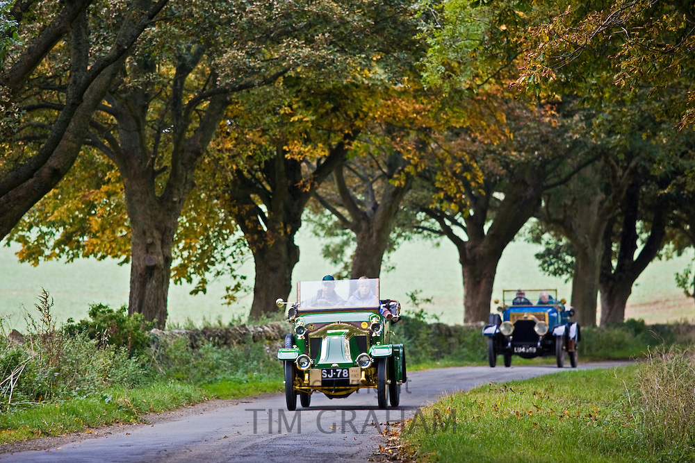 1912 Renault vintage car, followed by vintage Fiat on a Veteran Car Club rally The Cotswolds, UK