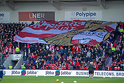Doncaster Rovers fans move a large Doncaster Rovers flag around of stadium during the The FA Cup 5th round match between Doncaster Rovers and Crystal Palace at the Keepmoat Stadium, Doncaster, England on 17 February 2019.