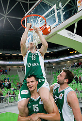 Bojan Krivec of Krka, Jure Balazic of Krka and Jure Lalic of Krka celebrate after the basketball match between KK Union Olimpija and KK Krka in 4th Final match of Telemach Slovenian Champion League 2011/12, on May 24, 2012 in Arena Stozice, Ljubljana, Slovenia.  Krka defeated Union Olimpija third time and became Slovenian National Champion 2011/12. (Photo by Vid Ponikvar / Sportida.com)