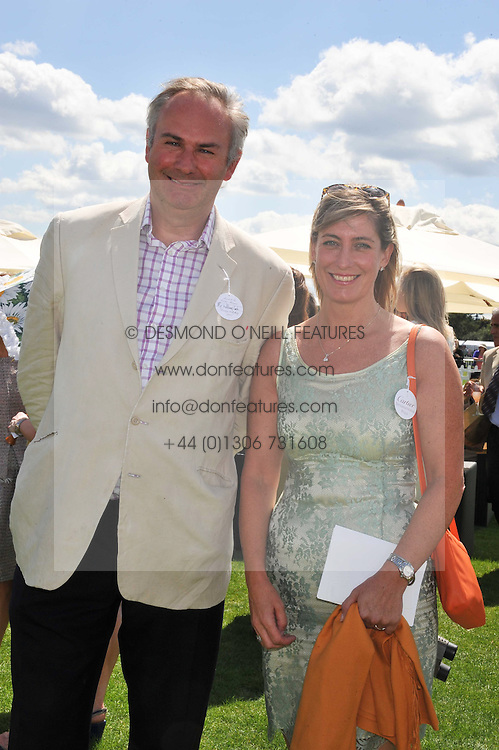 WILLIAM CASH and KiM ERLICH at the 27th annual Cartier International Polo Day featuring the 100th Coronation Cup between England and Brazil held at Guards Polo Club, Windsor Great Park, Berkshire on 24th July 2011.