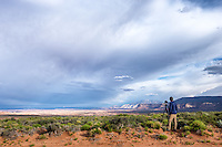 A photographer takes photos of the vast open space in Grand Staircase-Escalante National Monument, Utah
