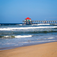 Huntington Beach Pier is a registered historic place and has a Ruby's Restaurant at the end. Huntington Beach is a seaside beach city along the Pacific Ocean in Orange County Southern California and is also known as Surf City USA.