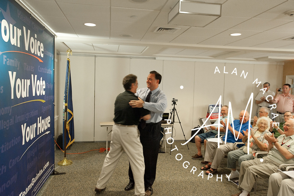 Former Franklin Mayor Tony Giunta embraces Congressional candidate Frank Guinta after introducing him to a group of voters during a town hall meeting at the Taylor Community on Tuesday, August 10, 2010.  (Alan MacRae/for the Citizen)