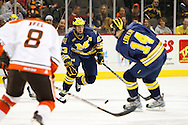 November 21, 2009:  BGSU's Ian Ruel (8), Michigan wing Like Glendening (23) and Michigan wing Brian Lebler (14) during the NCCA hockey game between Michigan and the Bowling Green State University at Lucas County Arena in Toledo, Ohio.