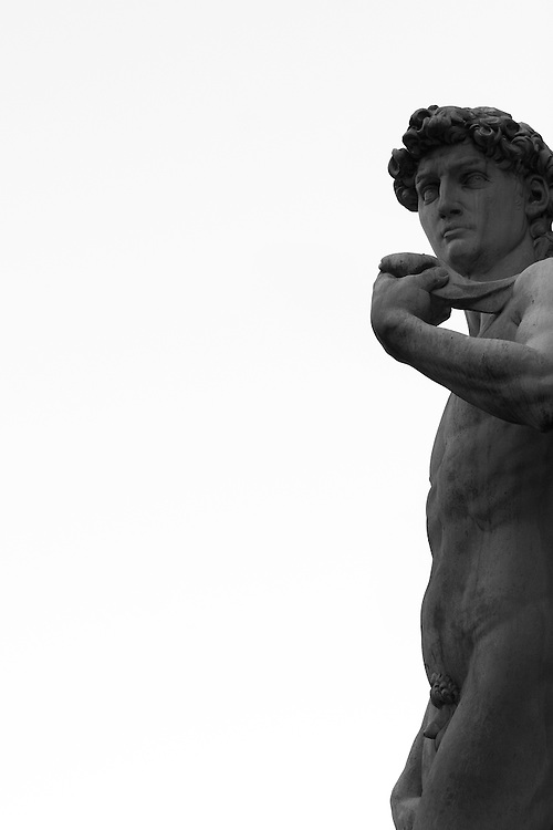 "Black and white photograph of the famous statue of David by artist Michelangelo in Florence Italy. This photograph is available as open edition print and limited edition print in four sizes. Click on ""Get Print"" to see more details."