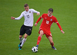 NEWPORT, WALES - Monday, October 14, 2019: Austria's Lars Nussbaumer (L) and Wales' Rhys Hughes during an Under-19's International Friendly match between Wales and Austria at Dragon Park. (Pic by David Rawcliffe/Propaganda)