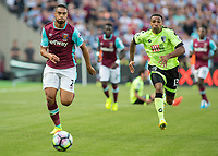 Football - 2016 / 2017 Premier League - West Ham United vs. AFC Bournemouth<br /> <br /> Winston Reid of West Ham and Bournemouth's Callum Wilson in a race for the ball at The London Stadium.<br /> <br /> COLORSPORT/DANIEL BEARHAM