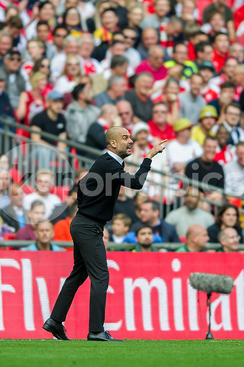 Josep Guardiola manager of Manchester City shouts instructions during the The FA Cup Semi Final match between Arsenal and Manchester City at Wembley Stadium, London, England on 23 April 2017. Photo by Salvio Calabrese.