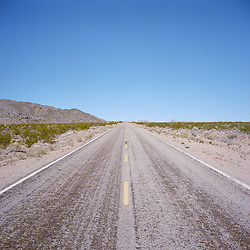 Desert highway in the Mojave National Preserve, CA.
