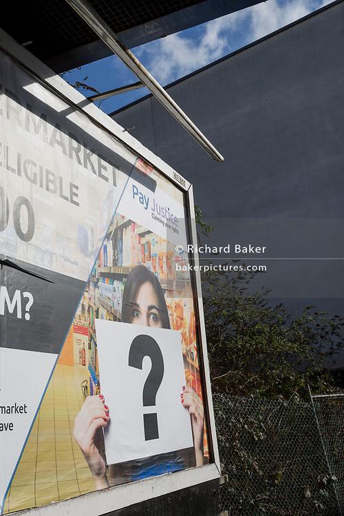 A south London landscape with a question mark being held in the context of a billboard ad, on 10th February 2019, in London, England.