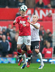 MANCHESTER, ENGLAND - Sunday, September 19, 2010: Liverpool's Martin Skrtel and Manchester United's Wayne Rooney during the Premiership match at Old Trafford. (Photo by David Rawcliffe/Propaganda)