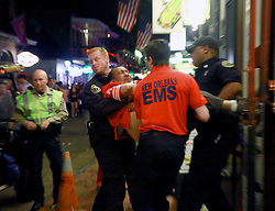 03 Feb 2013. New Orleans, Louisiana USA. .Bourbon Street. Paramedics rush a man from a bar..Photo; Charlie Varley