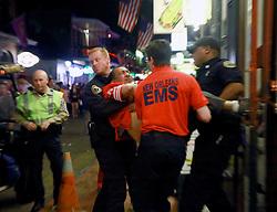03 Feb 2013. New Orleans, Louisiana USA. .Bourbon Street. Paramedics rush a man from a bar..Photo; Charlie Varley