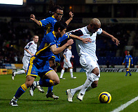 Photo: Jed Wee.<br /> Bolton Wanderers v Tottenham Hotspur. The Barclays Premiership. 07/11/2005.<br /> <br /> Bolton's El Hadji Diouf (R) tries to get into the Tottenham penalty area.