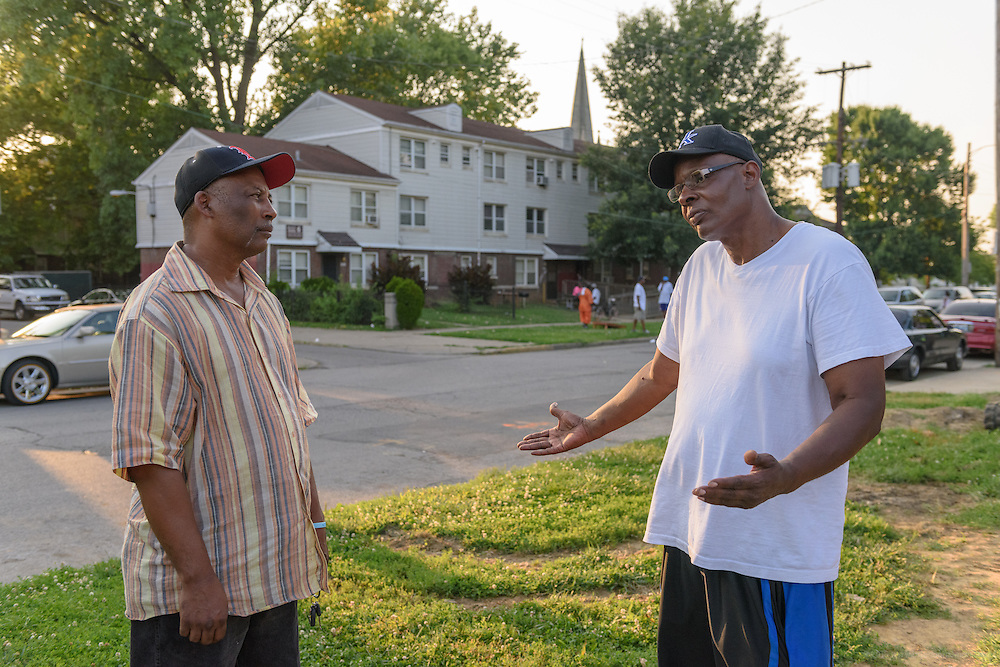 Norman Martin, Street Peace's team coordinator, left, speaks with Willee Hendricks on 12th Street Monday, June 20, 2016 along Baxter Park in the Beecher Terrace neighborhood. Hendricks lost two sons, Robert and Johnny, to gun violence in 2014. (Photo by Brian Bohannon)
