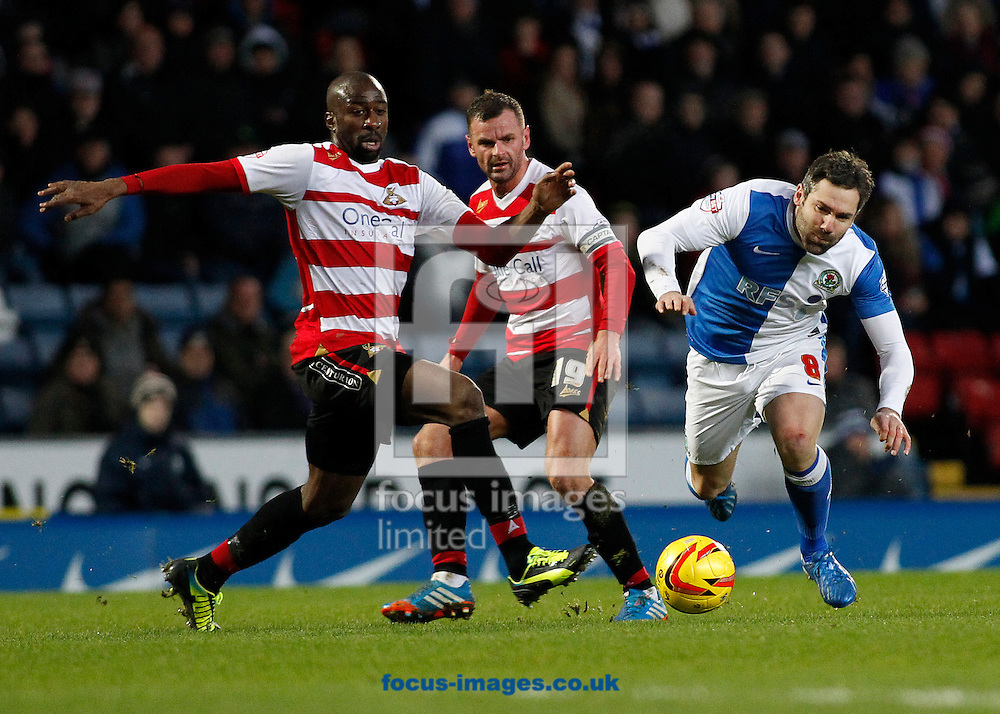 Picture by Michael Sedgwick/Focus Images Ltd +44 7900 363072<br /> 11/01/2014<br /> David Dunn of Blackburn Rovers and Abdoulaue Meite of Doncaster Rovers in action during the Sky Bet Championship match at Ewood Park, Blackburn.