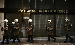 Greek riot police safeguard a bank branch in Athens, capital of Greece, March 5, 2010. Thousands of Greeks march in downtown Athens on Thursday night during a demonstration organized by trade unions to protest the new austerity measures announced by the government. Photo by Xinhua/Imago/i-Images