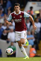 West Ham United's James Tomkins runs with the ball - Photo mandatory by-line: Mitchell Gunn/JMP - Tel: Mobile: 07966 386802 06/10/2013 - SPORT - FOOTBALL - White Hart Lane - London - Tottenham Hotspur V West Ham United - Barclays Premiership