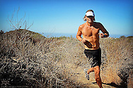 Author and fitness expert Craig Cooper running single track in Newport Beach, CA.