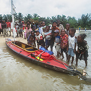 I was driven to Foulpointe and had to reassemble my kayak on the beach in torrential rain. I attracted a large crowd of onlookers including lots of excited children just as I did when I first assembled and launched my kayak at Tamatave. The local people were fascinated that I had a folding kayak inside two bags. Unfortunately I wasn't able to impress them with any degree of composure and speed with which I assembled the kayak, because the wooden frame became covered with sand in the pouring rain, making the assembly much more difficult. One sweet little girl held an umbrella over my head as I struggled to re-assemble it, with blood running from cuts on my agitated hands; it was one of those situations when I could have done without an audience! <br /> Eventually I was able to launch my kayak with much clapping and cheering from my faithful audience. I paddled around the point and discovered that beyond the protection of the coral reef in front of town there were still ranks of intimidating breakers extending as far as the eye could see. I didn't want a repetition of the first day so I decided to exercise caution and find another car to take me to Soaniarana-Ivongo. From there I would catch the ferry to Isle Sainte Marie, a popular tourist destination from where the migrating humpback whales can often be seen. I wasn't too discouraged by the sea conditions beyond there because I knew that north of Isle Ste. Marie there are long stretches of coastline sheltered by coral reefs – according to my maps anyway.