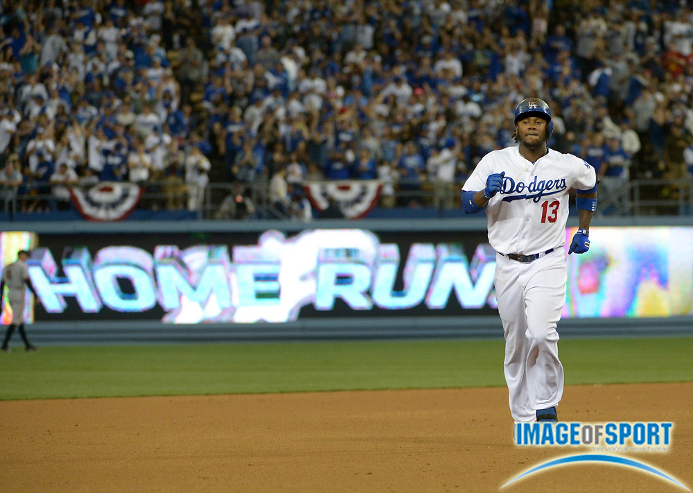 Apr 6, 2014; Los Angeles, CA, USA; Los Angeles Dodgers shortstop Hanley Ramirez (13) rounds the bases after hitting a home in the fourth inning against the San Francisco Giants at Dodger Stadium. Ramirez hit two home runs in the Dodgers 6-2 victory.