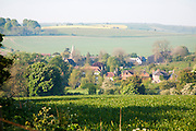 Nucleated village of East Kennett in valley floor of chalk countryside, Wiltshire, England, UK