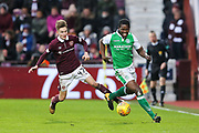 Efe Ambrose (#25) of Hibernian dribbles away from Harry Cochrane (#47) of Heart of Midlothian during the William Hill Scottish Cup 4th round match between Heart of Midlothian and Hibernian at Tynecastle Stadium, Gorgie, Scotland on 21 January 2018. Photo by Craig Doyle.