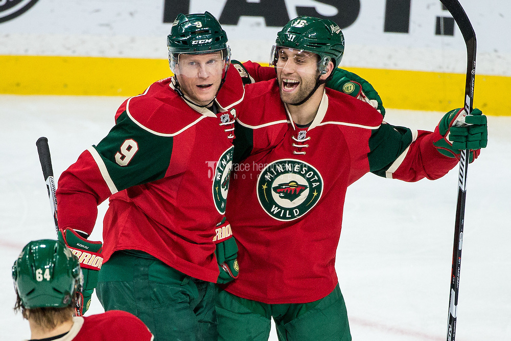 Dec 13, 2016; Saint Paul, MN, USA; Minnesota Wild forward Mikko Koivu (9) celebrates his goal with forward Jason Zucker (16) during the third period against the Florida Panthers at Xcel Energy Center. The Wild defeated the Panthers 5-1. Mandatory Credit: Brace Hemmelgarn-USA TODAY Sports