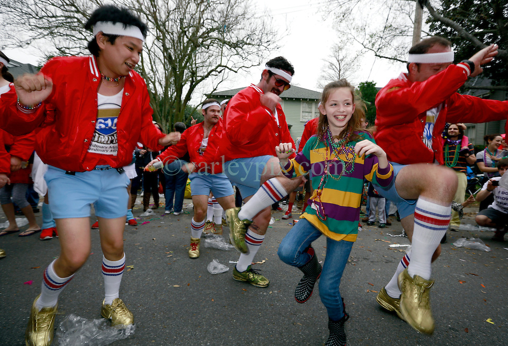 10 February 2013. New Orleans, Louisiana. .Mardi Gras. The Krewe of Thoth, in existence since 1947 parades through Uptown New Orleans. Members of the 610 Stompers male dance troupe accompanies Thoth through the streets..Photo; Charlie Varley.
