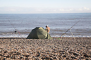 Small tents used for shelter by fishermen on the beach at Aldeburgh, Suffolk, England