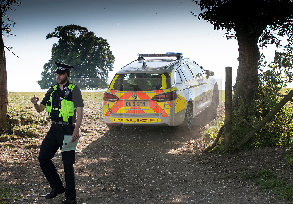 © Licensed to London News Pictures. 25/08/2019. Henley, UK. Police guard a field near Stonor, Oxfordshire where a light aircraft crashed yesterday. Two people are reported to have died. Photo credit: Peter Macdiarmid/LNP