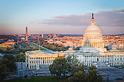 USA, Washington, D.C. The U.S. Capitol Building,the National Mall, and Northwest Washington in autumn sunrise light as seen from the Library of Congress