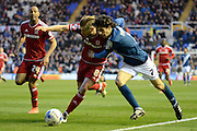 Birmingham City striker Diego Fabbrini and Middlesbrough midfielder Adam Clayton tussle for the ball during the Sky Bet Championship match between Birmingham City and Middlesbrough at St Andrews, Birmingham, England on 29 April 2016. Photo by Alan Franklin.
