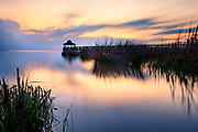 Long exposure of Kitty Hawk bay and gazebo silhouette on the Outer Banks of NC.