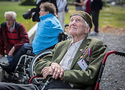 © Licensed to London News Pictures. 05/06/2014.   D Day veteran Ron Wood watches members of the Parachute Regiment jump out of a Dekota aircraft over the village of Ranville in Normandy as part of the 70th Anniversary of the D Day landings.  Photo credit : Alison Baskerville/LNP
