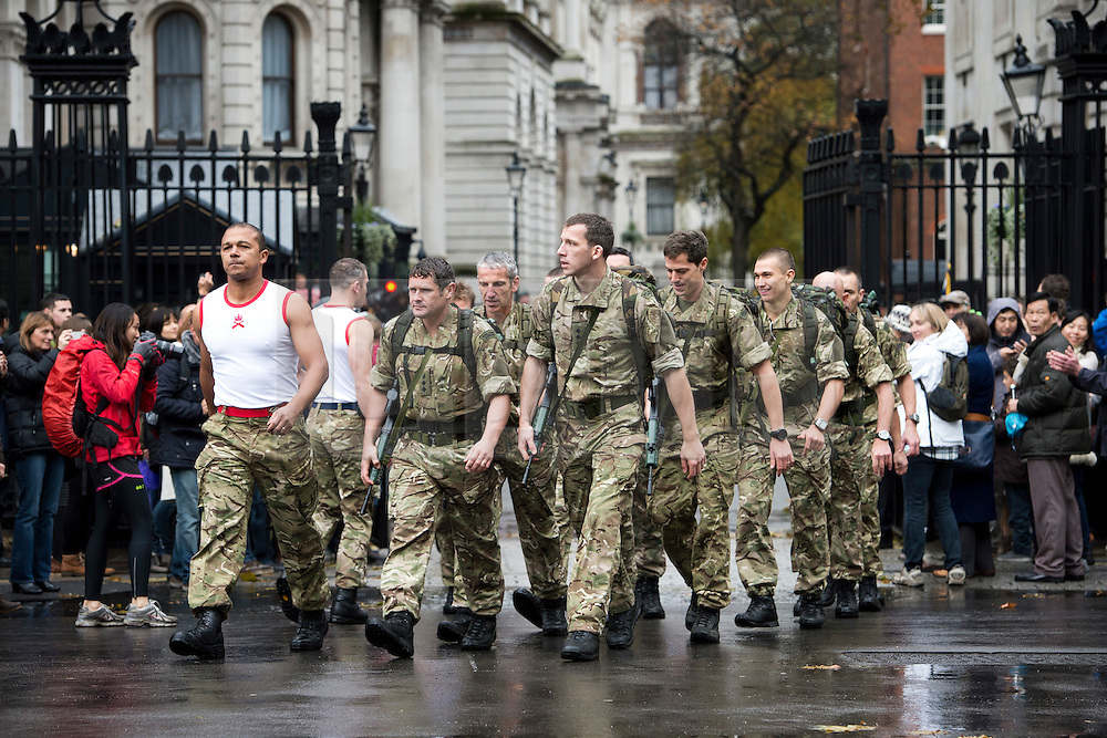 © London News Pictures. 10/11/2012. London, UK. Royal Marines from Commando 999  (Royal Marines who serve with the UK emergency services) setting off from Downing Street on a charity event in which the Royal Marines  speed march around London in record time to raise funds for wounded service personnel. The Marines met British Prime Minister David Cameron on Downing Street before taking part in the charity event which takes place on Remembrance weekend.  Photo credit: Ben Cawthra/LNP